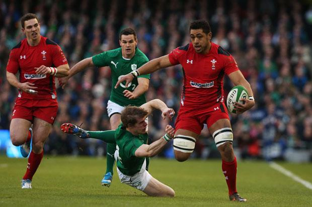 Wales' Taulupe Faletau is tackled by Ireland's Andrew Trimble