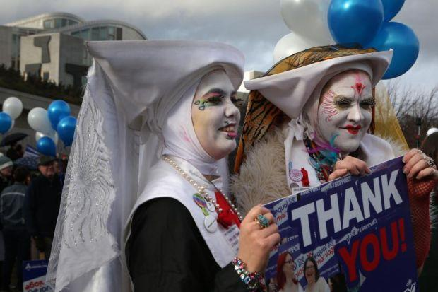 Students, religious representatives and campaigners in fancy dress were among those who gathered for a rally outside the Scottish Parliament on Tuesday