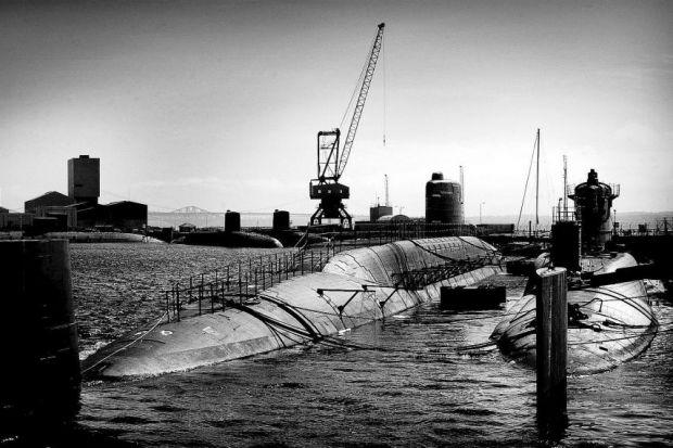 Two of the seven decommissioned  nuclear submarines at Babcock's docks at Rosyth in FifePhotograph: Stewart Attwood