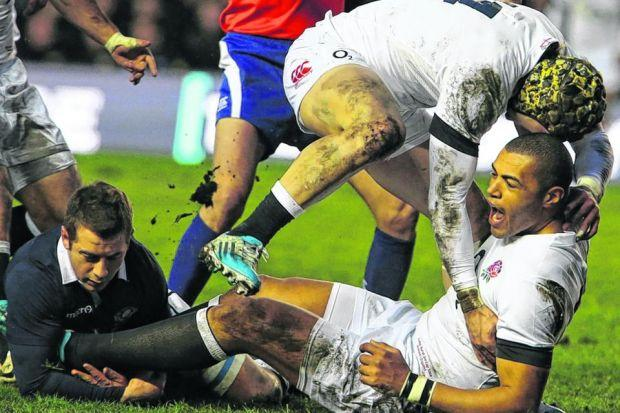 Greig Laidlaw is unable to prevent Luther Burrell scoring England's first try. Picture: Stewart Attwood