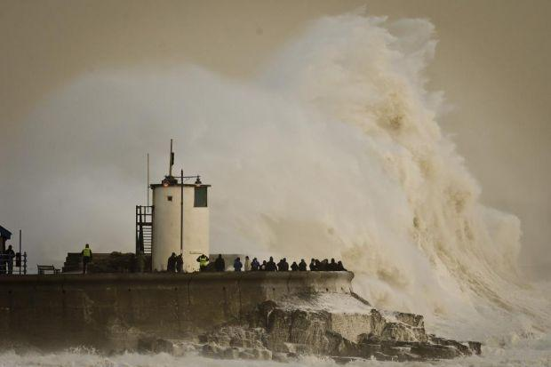STORM CHAOS: The flooding in the south of England continued as the gales swept over the country.