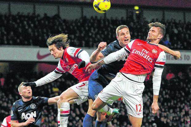 Olivier Giroud jostles for the ball with Nemanja Vidic; the striker should have scored at least once. Picture: EPA