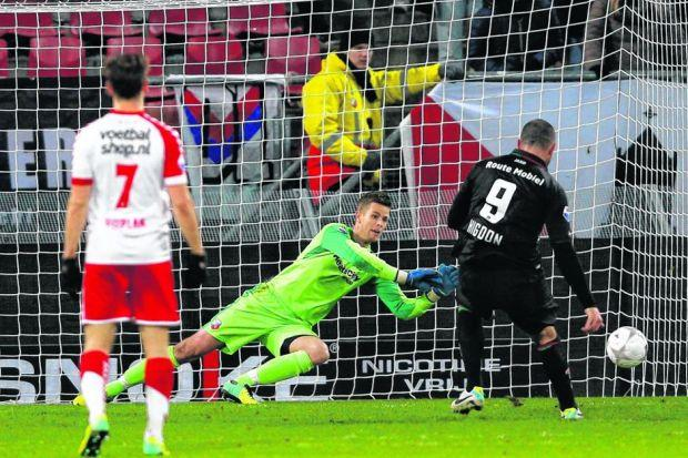 Robbin Ruiter of FC Utrecht saves a penalty from Michael Higdon, who thinks he should have scored more than his nine goals so far. Picture: Getty Images