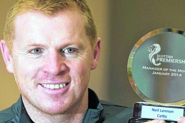 Neil Lennon with his January SPFL manager of the month award. Picture: Jeff Holmes/PA Wire
