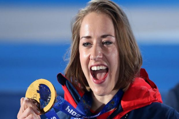 Lizzy Yarnold shows off her gold medal   Photograph: PA