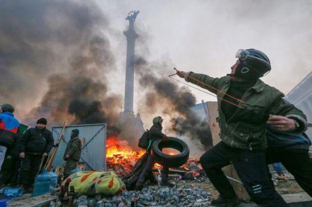 DEADLY VIOLENCE: Thousands of defiant protesters clashed with riot police in Kiev's Independence Square.