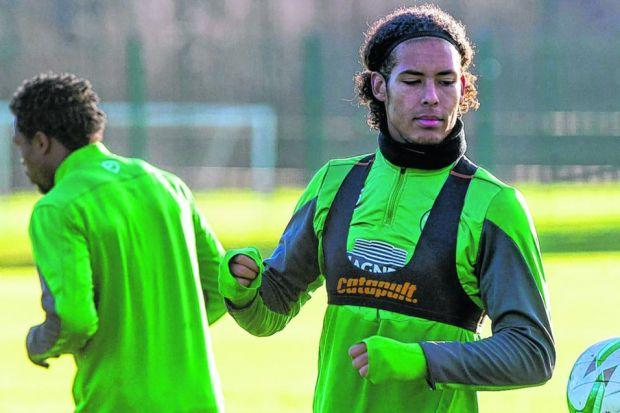 Virgil van Dijk might have to watch his defensive partner Efe Ambrose play at the  World Cup from afar. Picture: SNS
