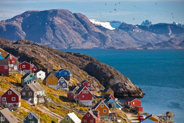 The colourful Inuit village of Kangaamiut, western Greenland, whose residents demonstrate their traditional crafts and customs to visitors. Photograph: John Sylvester/Alamy