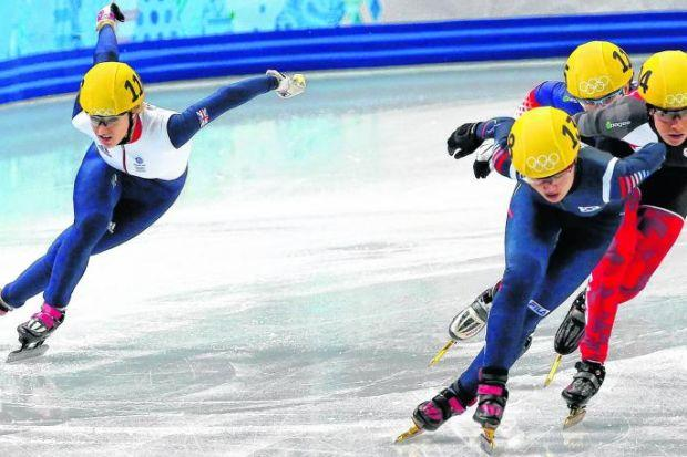 Elise Christie makes her move to qualify from the short track quarter-finals but her ambitions of winning an Olympic medal would end in controversial circumstances following a crash in the semi-finals. Picture: EPA