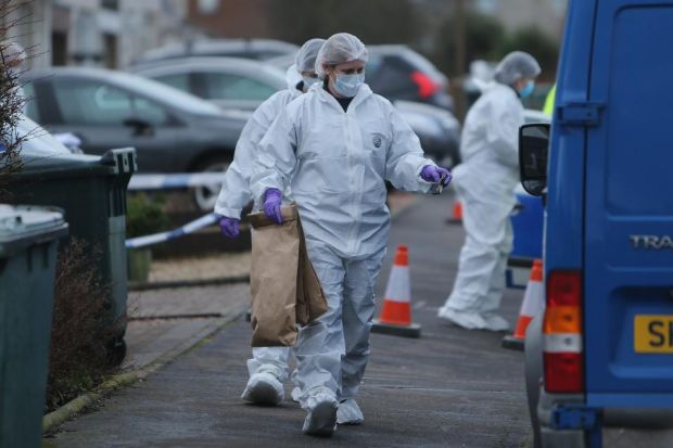 DEATHS PROBE: Forensics officers remove material from the house as they continue to search the home of the tragic couple. Picture: Gordon Terris