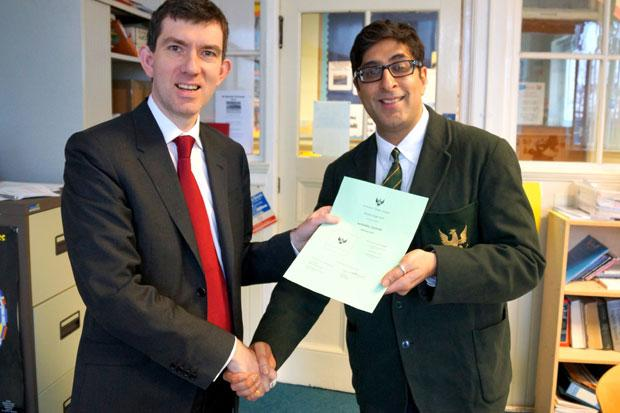 Sanjeev is pictured by headteacher John Brown.