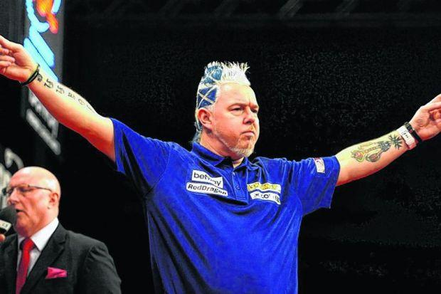 Peter Wright was typically colourful as he got the home crowd going with an opening victory against Englishman Adrian Lewis. Picture: SNS