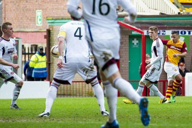 Motherwell's Lionel Ainsworth, right, scores his side's second goal of the game at Fir Park. Picture: SNS
