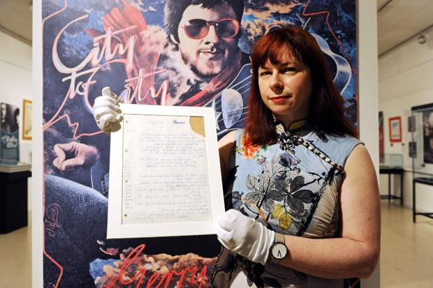 Museum curator Andrea Kusel with Gerry Rafferty's handwritten lyrics to Baker Street