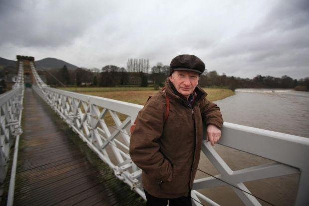 Alan Taylor on the suspension bridge that connects Melrose and Gattonside. Photograph: Steve Cox