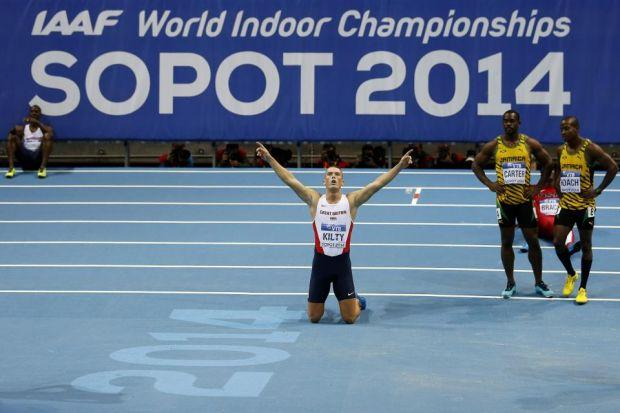 Britain's Richard Kilty celebrates his astonishing victory in the 60 metres final                        Photograph: EPA