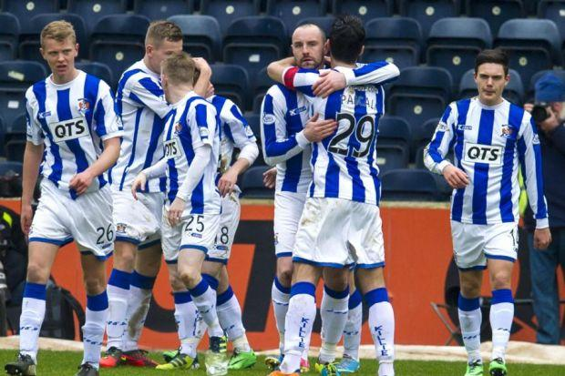Kilmarnock captain Manuel Pascali (No.29) congratulates Kris Boyd after the striker scored his second goal of the afternoon