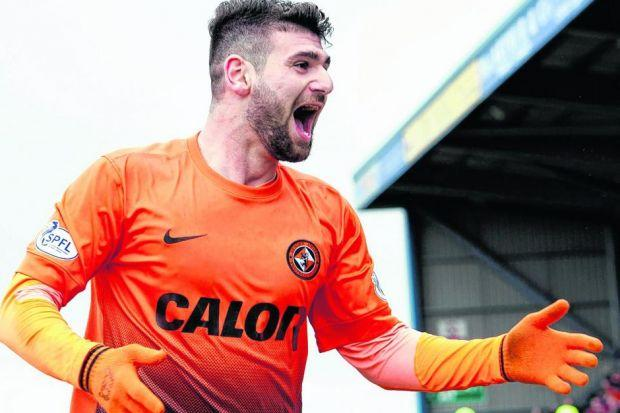 Dundee United's stand-out performer Nadir Ciftci celebrates after scoring his second goal of the game at Caledonian Stadium yesterday. Picture: SNS