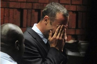 Pistorius vomits during murder trial as he hears graphic details of Reeva Steenkamp's injuries