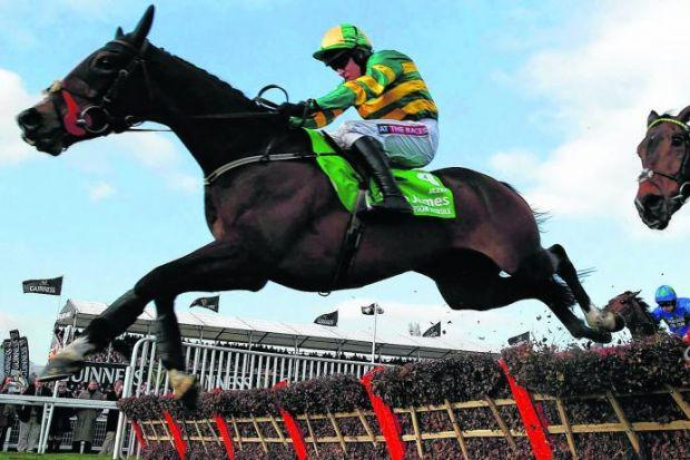 Jezki and Barry Geraghty clear the final fence ahead of My Tent Or Yours, ridden by Tony McCoy, on their way  to winning  the Champion Hurdle.  Picture: Reuters