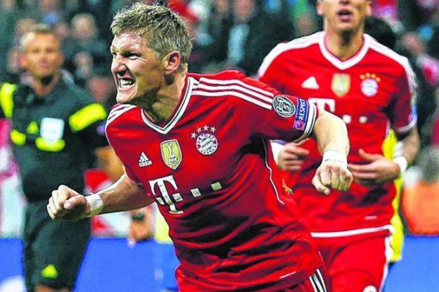 Schweinsteiger celebrates putting Bayern on their way to a 5-1 aggregate victory. Picture: Reuters