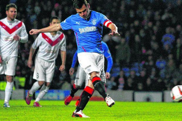Lee McCulloch dispatches his first penalty which helped Rangers to a 3-0 win over Airdrieonians and to the League 1 title. Picture: Colin Mearns
