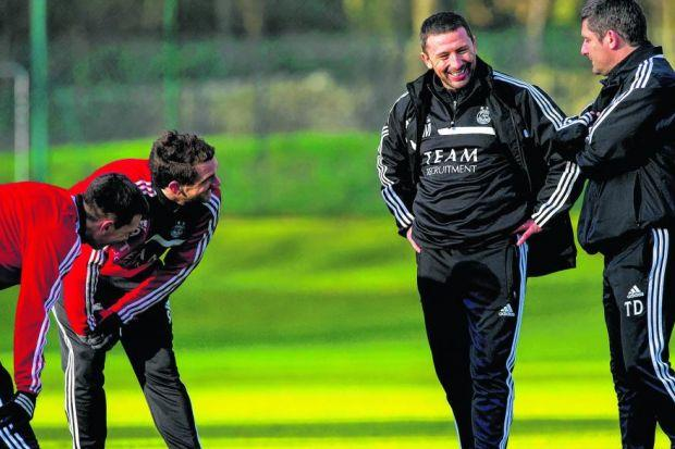 Reasons to smile: Derek McInnes and his assistant Tony Docherty, who signed extended contracts with Aberdeen yesterday. Picture: SNS