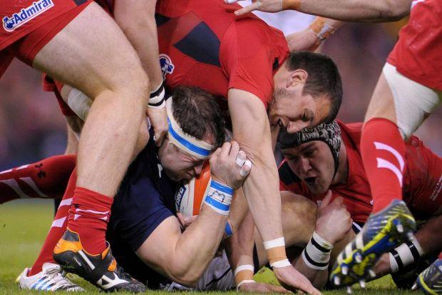 Scotland's Ryan Grant finds himself in a tight squeeze as the Welsh players run rampant Photograph: PA