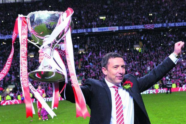 Derek McInnes parades the Scottish League Cup at Celtic Park yesterday. Picture: SNS