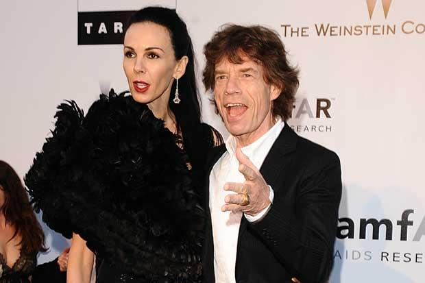 Stones tour off as Jagger pays tribute to lover L'Wren