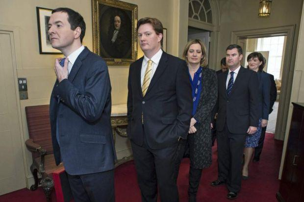 leading THE WAY: Chancellor of the Exchequer George Osborne, with his Treasury team, prepares to face the Commons with his Budget statement.  Picture: Reuters