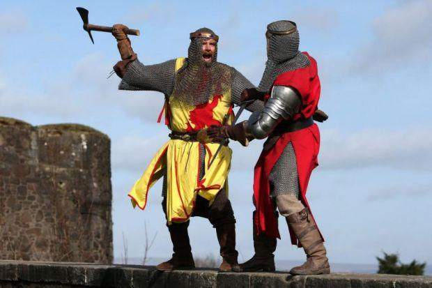 ATTACK: Roy Ramsey as Robert the Bruce in battle with Roy Murray, playing Edward ll, at Stirling Castle during the festival launch. Picture: Andrew Milligan