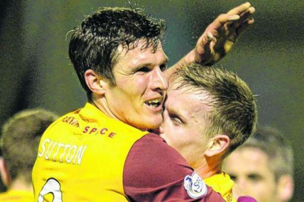 Hammell, pictured celebrating with John Sutton, believes finishing second would be the best achievement yet for Motherwell. Picture: SNS