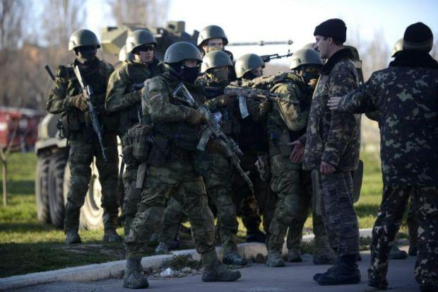 Tensions rise in Crimea as troops storm air force base