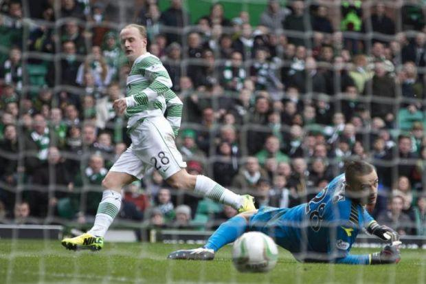 Leigh Griffiths, who set up Celtic's first goal on 44 minutes, beats the Kilmarnock goalkeeper for his side's second. Picture: SNS