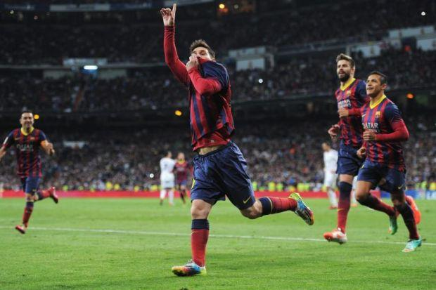 Lionel Messi of Barcelona celebrates one of three goals at the Bernabeu that took him past Alfredo di Stephano's record in Barcelona-Madrid derbies. Picture: Gonzalo Arroyo Moreno/Getty Images