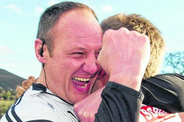 Melrose coach John  Dalziel celebrates Saturday's title victory