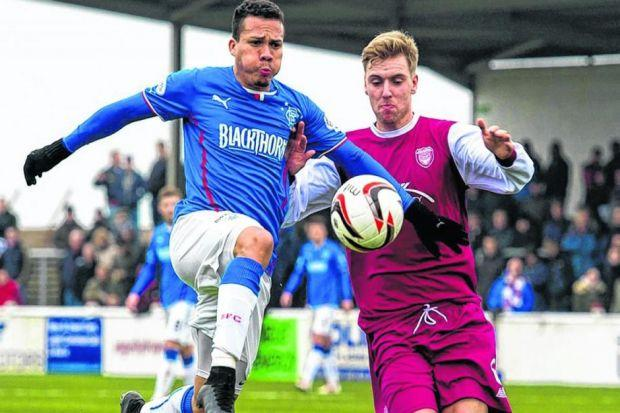 The less-than-impressive Arnold Peralta, left, battles for the ball with Arbroath's Johnny Lindsay. Picture: SNS