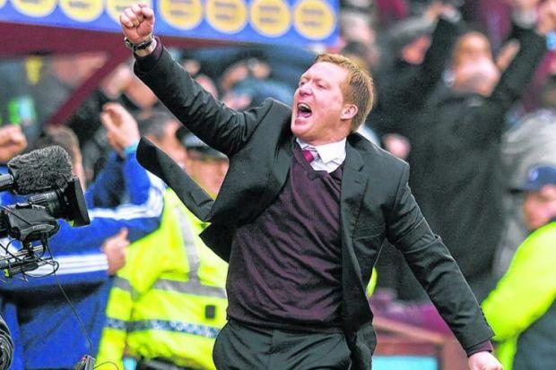 Hearts manager Gary Locke celebrates his side's win, and their stay of execution. Picture: SNS