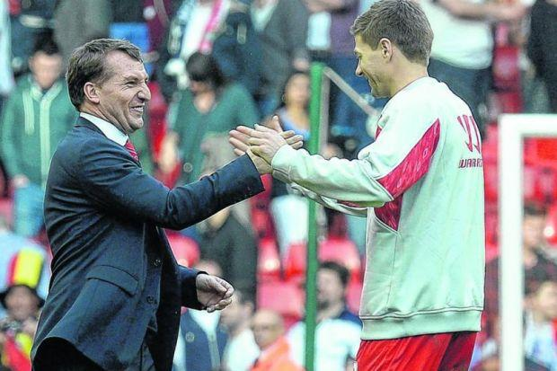 Brendan Rodgers and Steven Gerrard celebrate  as Liverpool take top spot. Picture: SNS
