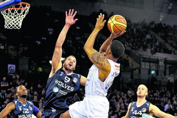 Chris Johnson of the Rocks is blocked by Wolves' Stefan Djukic last night. Picture: Nick Ponty