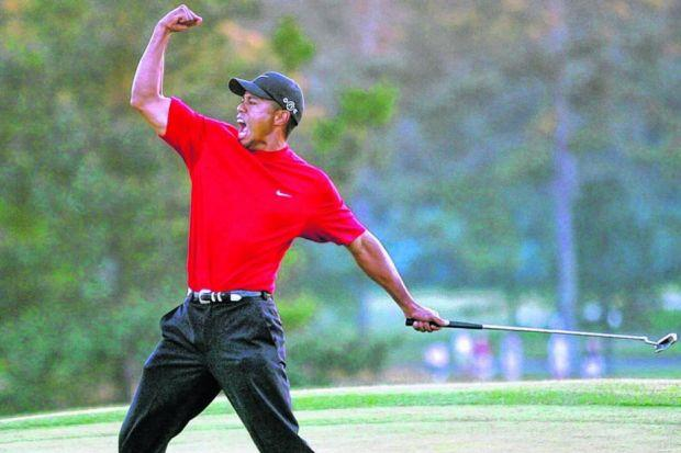 Tiger Woods celebrates after sinking a putt on the first play-off hole to win the 2005 Masters. Picture: Getty Images