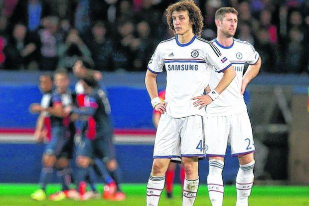 David Luiz and Gary Cahill look forlorn as PSG player celebrate Javier Pastore's killer goal. Picture: Mike Egerton/PA