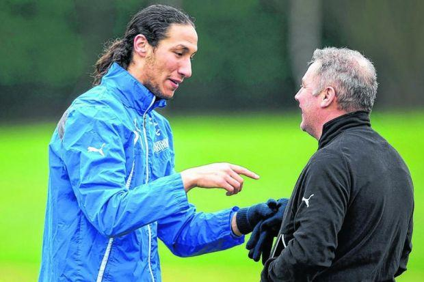 Bilel Mohsni and Ally McCoist share a joke ahead of tomorrow's showdown at Easter Road. Picture: SNS