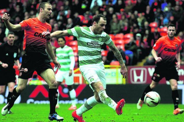 Anthony Stokes gets in front of Sean Dillon todouble Celtic's lead Photograph: SNS