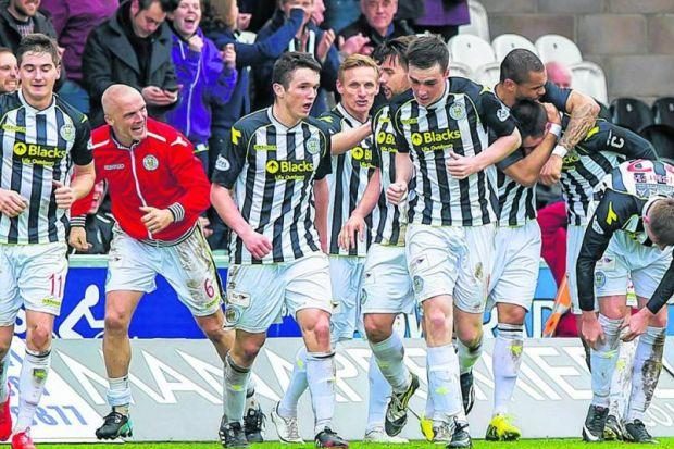 Steven Thompson, second right, is congratulated by his St Mirren team-mates after his late winner, and 16th goal of the season. Picture: SNS