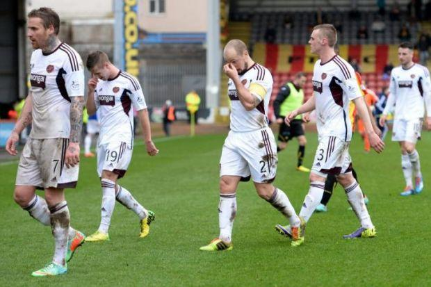 Dejected Hearts players leave the pitch at Firhill after relegation was confirmed. Picture: SNS