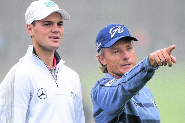 Martin Kaymer of Germany listens to the wisdom of his compatriot, the veteran Bernhard Langer, during the opening practice round at Augusta yesterday.  Picture: Getty Images