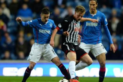 Moore tackling Rangers' Ian Black in a match last year