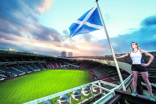 Eilidh Child atop Hampden adorns the cover of Shields and Black's book. Picture: Alistair Devine, courtesy of Commonwealth Games Scotland